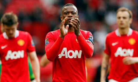Patrice Evra applauds the Manchester United fans