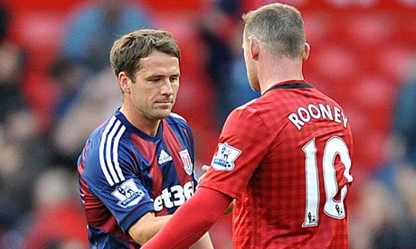 Michael Owen shakes hands with Manchester United's Wayne Rooney after Stoke's match at Old Trafford