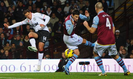 Javier Hernandez volleys a shot on goal for Manchester United against Aston Villa