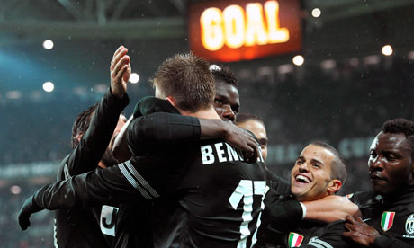 Team-mates congratulate Paul Pogba after scoring the winner for Juventus against Bologna