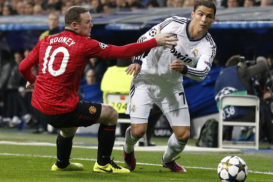 Rooney battles with Ronaldo in the first leg.