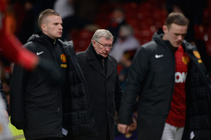 A dejected Alex Ferguson walks off