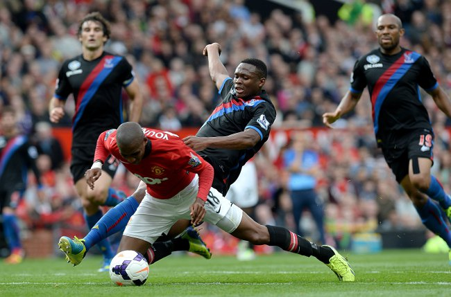 Ashley Young does his best to avoid another tweeter