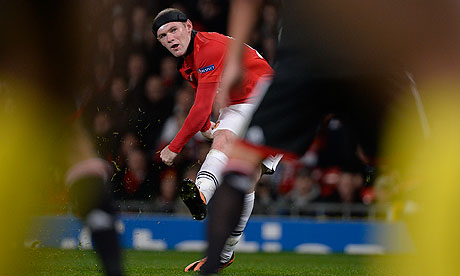 Wayne Rooney in action during Champions League against Bayer Leverkusen