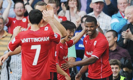 Fraizer Campbell, right, celebrates scoring Cardiff City's second goal