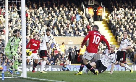 Manchester United's Wayne Rooney scores the third goal in the Premier League against Fulham