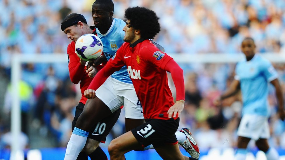 Yaya Toure out muscles Fellaini