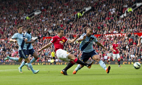 Manchester United's Robin Van Persie scores against West Ham United in the Premier League match
