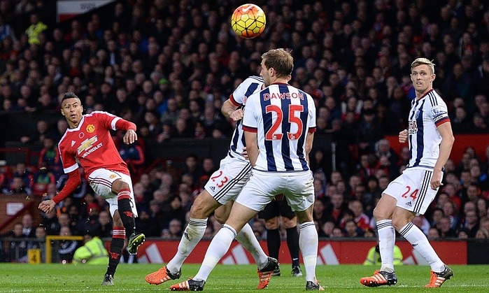 Jesse Lingard scores the opener against WBA