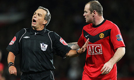 Rooney argues with ref