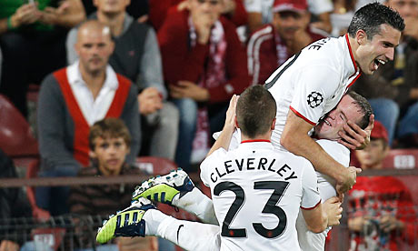 Robin van Persie celebrates with Wayne Rooney following a goal against CFR Cluj